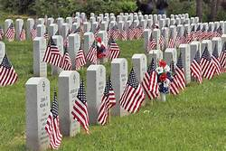 veterans cemetery with white headstones