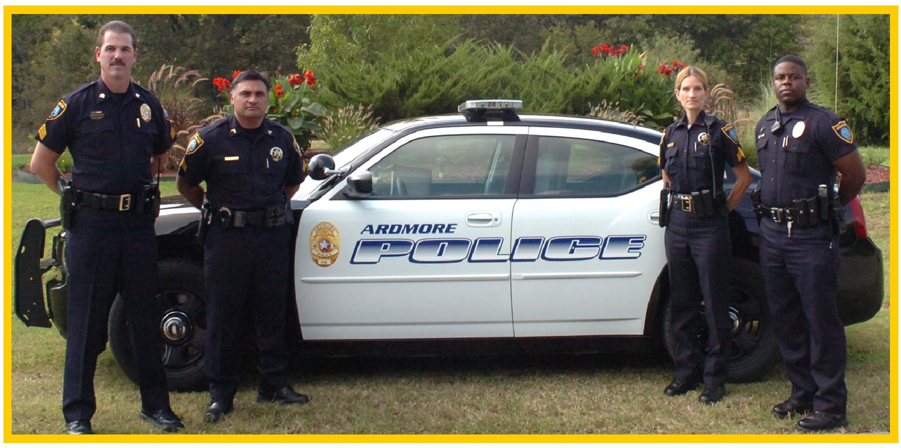 Ardmore officers pose near an Ardmore Police Cruiser